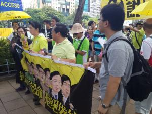 "Albert Ho (2nd from left), Chairman of the Hong Kong Alliance, at the ""The Citizens Against Pseudo-Universal Suffrage"" march, Hong Kong, June 14, 2015. HRIC photo."