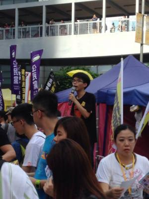 "Joshua Wong, convener of Scholarism, at the ""The Citizens Against Pseudo-Universal Suffrage"" march, Hong Kong, June 14, 2015. HRIC photo."