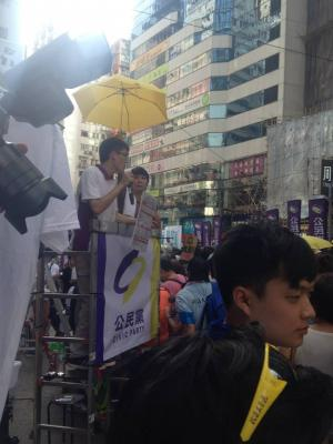 Members of the Civic Party, including Claudia Mo, address the crowd during the democracy march organized by Civil Human Rights Front, Hong Kong, July 1, 2015. HRIC photo.